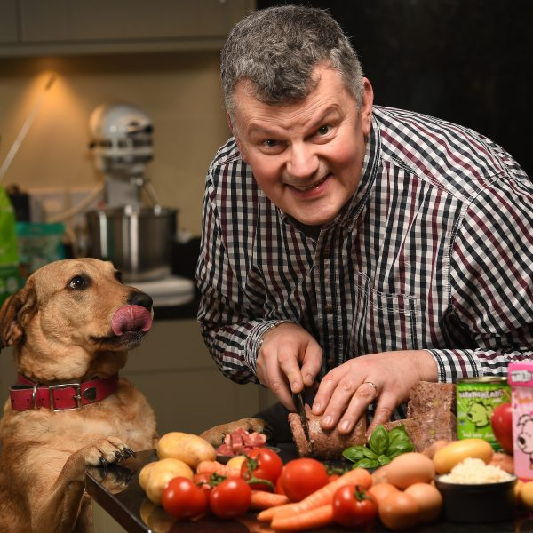PAUL HUNTER, CO-FOUNDER OF BARKINGHEADS & MEOWING HEADS, PET FOODS HAS SECURED MORE INVESTMENT IN THE BUSIESS HE STARTED WITH TWO FRIENDS WHICH PACKS QUALITY VEG, MEAT AND FRUIT INTO THEIR PRODUCTS TO PROVIDE  HEALTHIER LIFESTYLE FOR PETS. HE IS PICTURED WITH HIS OWN DOG, MACY.©RUSSELL SACH - 0771 882 6138